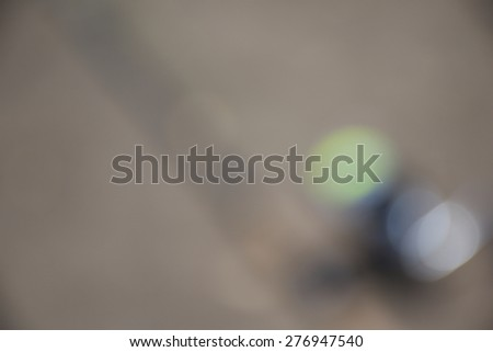 blurred Objects for fishing. The rod with reel under the sunlight - stock photo