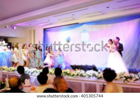 blurred of bride throwing bouquet for bridesmaids and groomsmen - stock photo
