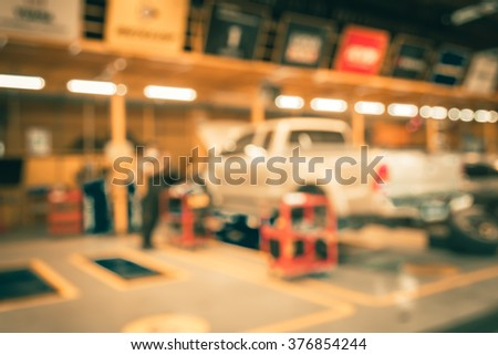 Blurred of car technician repairing the car in garage background - stock photo