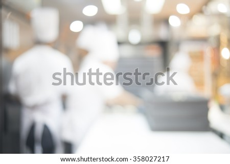 Blurred of Chef making baker in open kitchen, background uses