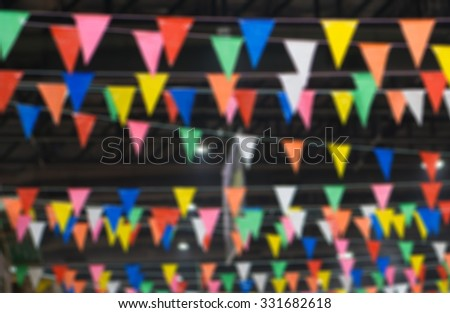 blurred of colorful festive bunting flags - stock photo
