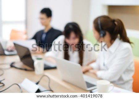 blurred of employee working call centre/hotline at office computer indoor room:group of people work about help-desk research training monitoring support.blur of assignment,business,technology concept - stock photo