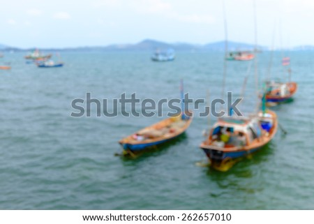 Blurred of fishing boats on the sea. - stock photo
