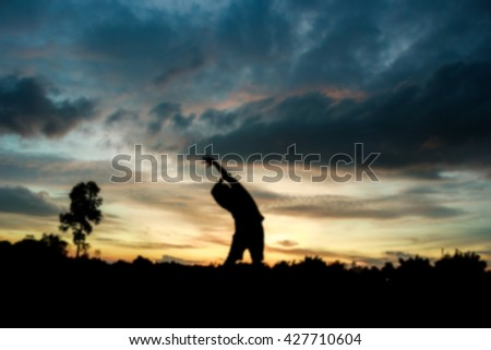 Blurred of Fitness on silhouette sunrise The boy  workout wellness concept. - stock photo