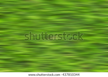 Blurred of green weed grasses on the ground.Simulated for moving high speed.