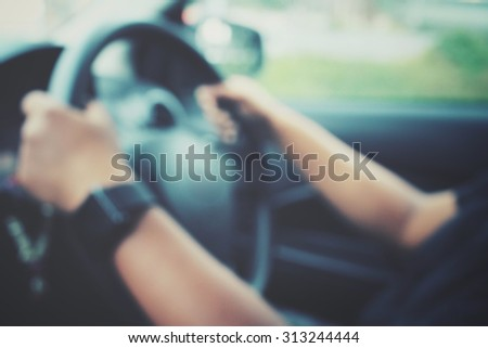 Blurred of hands drive a car