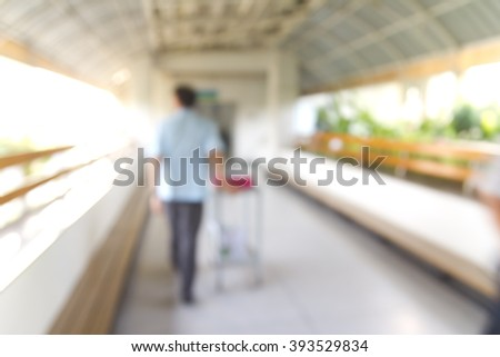 Blurred of hospital : Male male nurse walking in the corridor  - stock photo