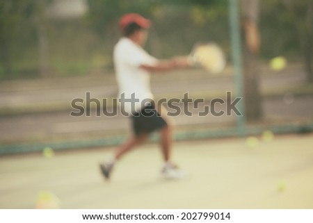 blurred of kid playing tennis - stock photo