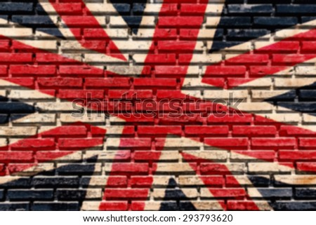 Blurred of old brick wall paint color copy British flag for texture background and backdrop. - stock photo