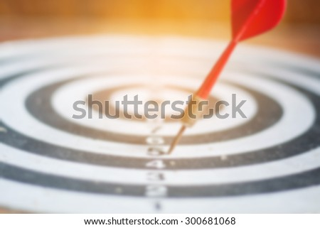 blurred of old dart target with arrows,vintage color tone ,abstract background to solution concept. - stock photo