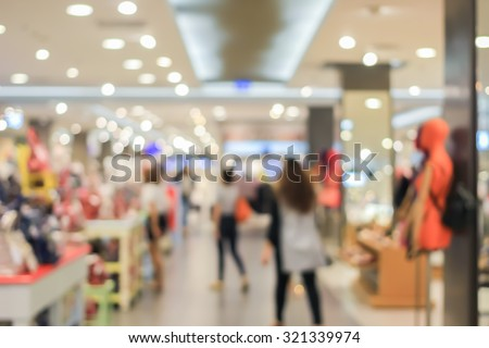 Blurred of people walking in shopping mall:blur of department store indoors with bokeh lights:out of focus concept:lifestyle concept:blurred of shopping mall.vacation weekend day discount concept. - stock photo
