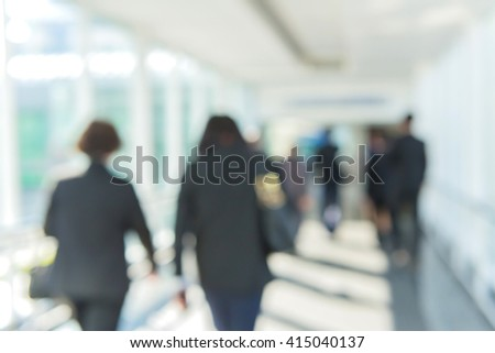 Blurred of people walking in the corridor of an business center, pronounced motion blur.