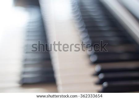 Blurred of Piano keyboard background. - stock photo