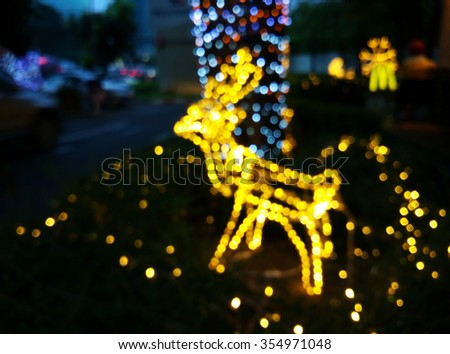 Blurred of Reindeer Bokeh for Christmas background - stock photo