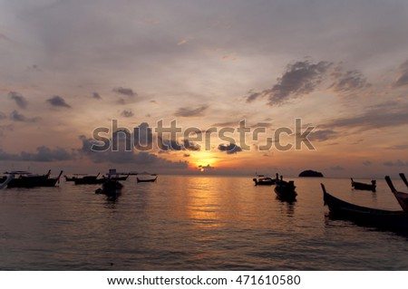 blurred of silhouette Traditional longtail boat on the sea at sunset light, Lipe island, Thailand