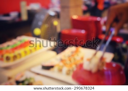 Blurred of sushi in restaurant