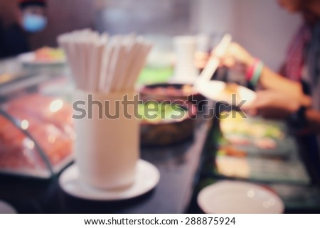 Blurred of sushi in restaurant at hotel