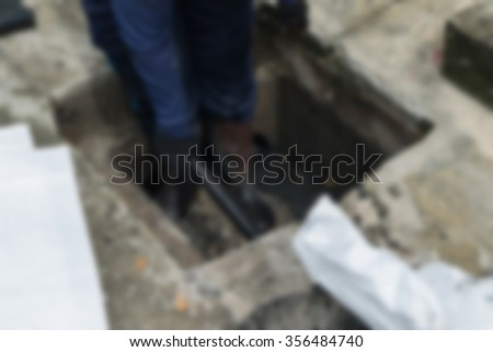 Blurred of Working for drain cleaning. Problem with the drainage system. - stock photo