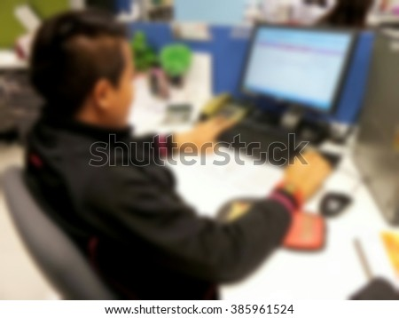 Blurred office employees are using the computer duties style vintage tone.