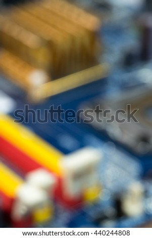 blurred out of focus blue pcb board integrated circuit pc parts motherboard chip processor texture background with copy-space - stock photo