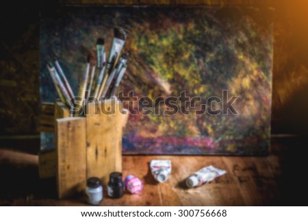 blurred paintbrushes,color and dirty photo flame on wooden background,vintage grunge style.  - stock photo