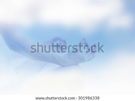 Blurred pastel image of healthy female in yoga pose. Peace, zen and inner harmony concept. - stock photo