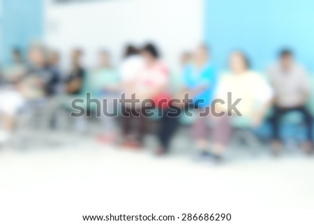 blurred patient waiting queue for seeing a doctor background - stock photo