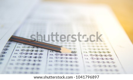 Blurred pencil on answer paper for examination in classroom