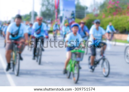 blurred people cycling together in the event BIKE FOR MOM - stock photo