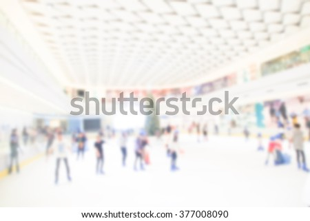 blurred people ice skating in shopping mall sport atmosphere - stock photo