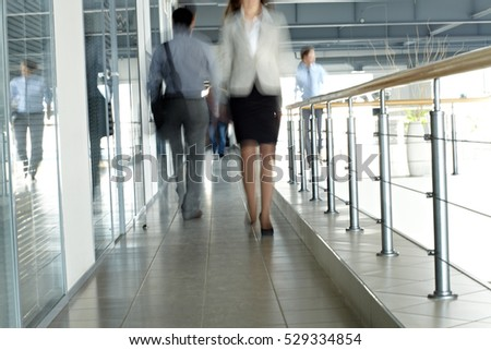 Blurred people in office
