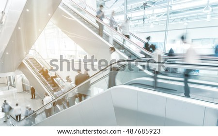 Blurred people on a escalator at a shopping mall