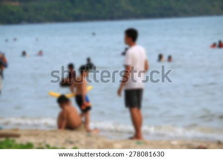 blurred people on the beach