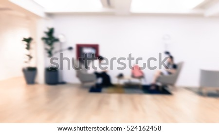 Blurred people sitting working at the workspace, abstract