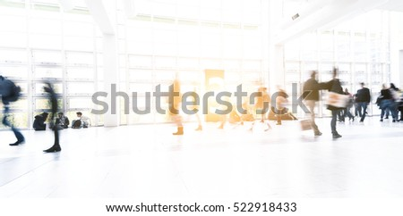 Blurred people using a walkway at a tradeshow