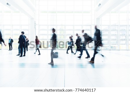 Blurred people walking in a modern environment