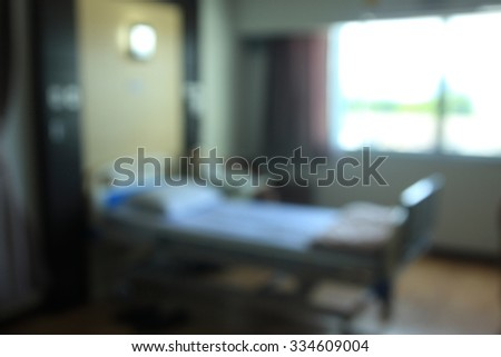 blurred photo Empty Bed on Hospital - stock photo