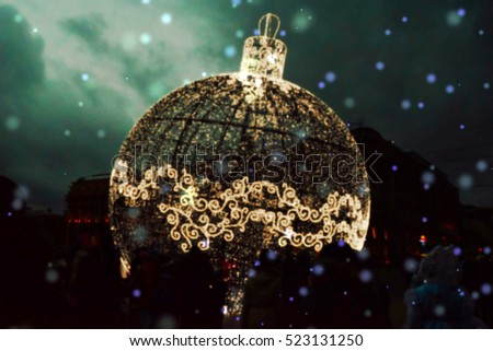 Blurred photo of a giant ornament decorated with many small lights. Suitable to be used for any christmas sales.