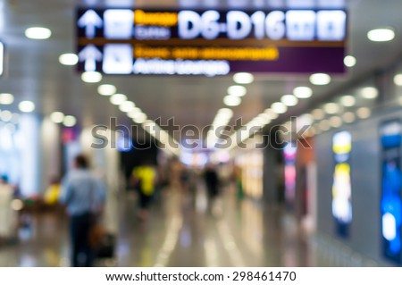 Blurred photo of Airports terminal. Airline Passengers in an International Airport. Travel background - stock photo