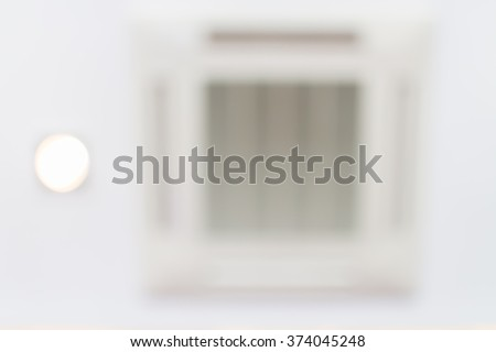Blurred photo of built-in air conditioner on the ceiling. - stock photo