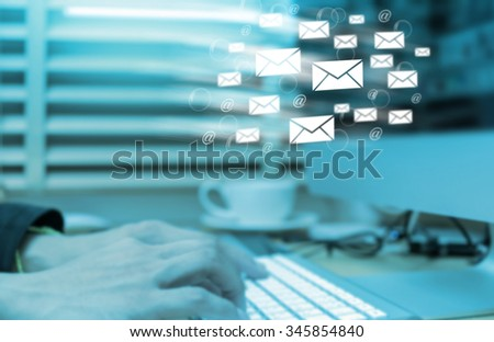 Blurred photo of Businessman hand pressing the keyboard for sending the e-mail from computer, business technology concept - stock photo