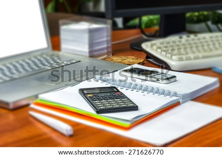 Blurred photo of close up of business stationery - stock photo