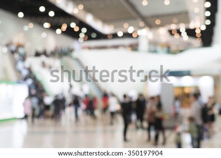 Blurred photo of escalators in modern building, background uses - stock photo