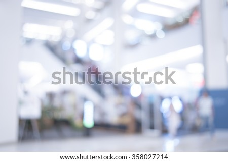 Blurred photo of escalators in modern building, background uses. - stock photo