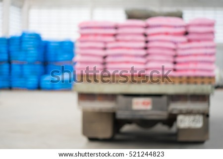 Blurred photo of fertilizer on the truck industry and factory.fertilizer in the warehouse.