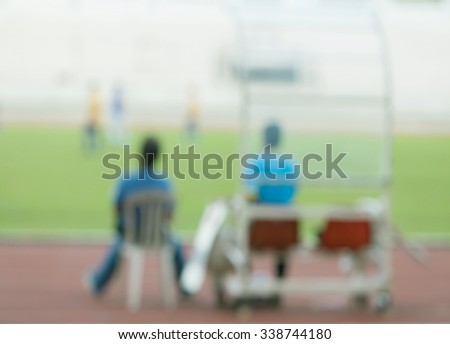 Blurred photo of football soccer players training with staff coach. - stock photo