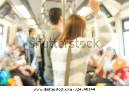 Blurred photo of passengers in sky train
