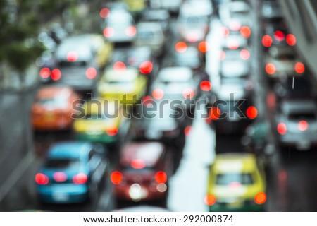 Blurred photo of  traffic jam in rainy day. Bangkok Thailand. - stock photo