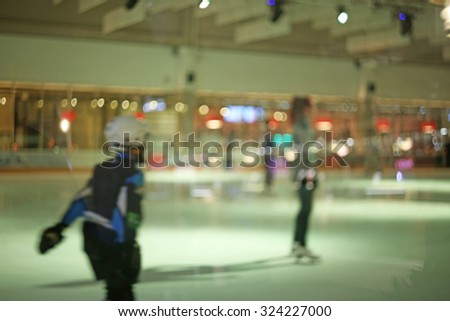 Blurred photo of young hockey player scating on an ice rink - stock photo