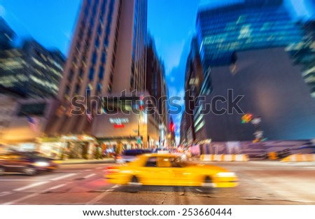 Blurred picture of Yellow Cab speeding up in the night, New York.